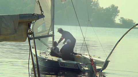 Family leaving dock in small sailing yacht, vacation, holiday Footage