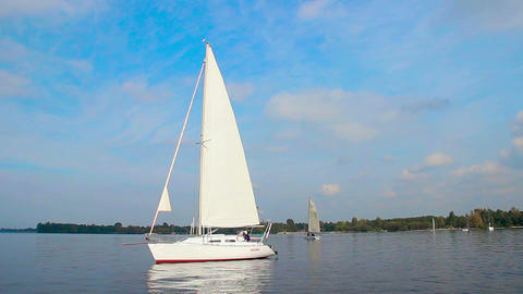Luxury sailing yacht on city river, vacation, holiday, hobby Live Action