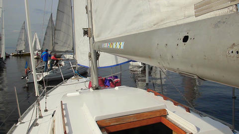 Numerous sailboats on sea, teams preparing for race, regatta Footage