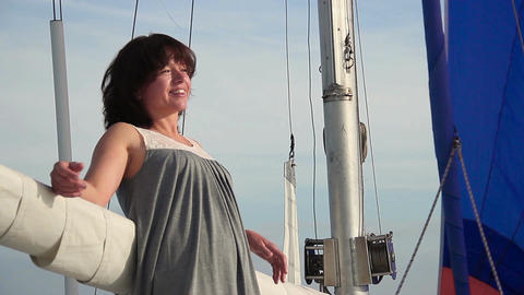 Happy smiling woman relaxing on sailboat, traveling, cruise Footage