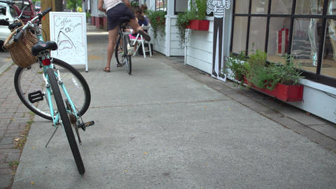Woman riding bike on sidewalk in summer Footage
