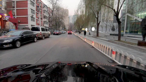 Timelapse front car vehicle driving in downtown city road, Beijing, China Live Action