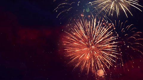 Shining fireworks explosions with bokeh lights in night sky Live Action
