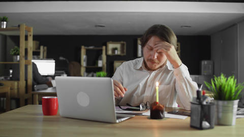 Sad and crying manager celebrating a lonely birthday in the office Live Action