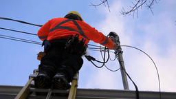 Telecommunications technician at work Live Action