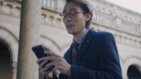 Student reading good news on phone. Businessman browsing internet on smartphone Live Action