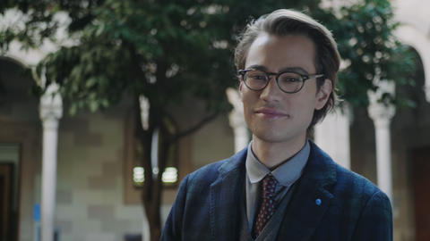 Student in eyeglasses laughing at camera. Businessman posing at camera outdoors Live Action