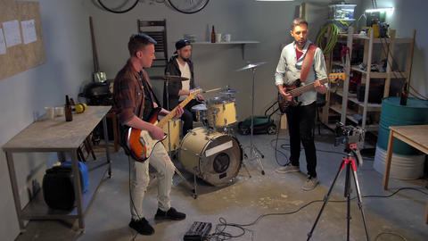 Music band having repetition in garage Live Action