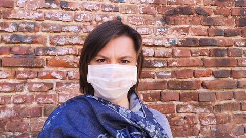 Portrait of a woman wearing protective mask. Health care and medical concept Live Action