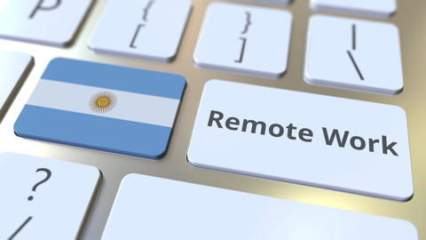 Remote Work text and flag of Argentina on the computer keyboard. Telecommuting Live Action