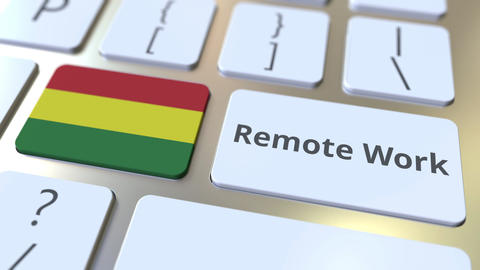 Remote Work text and flag of Bolivia on the computer keyboard. Telecommuting or ライブ動画
