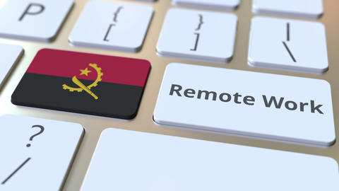 Remote Work text and flag of Angola on the computer keyboard. Telecommuting or Live Action