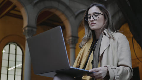 Student reading bad news on laptop screen at college. Businesswoman using laptop Live Action