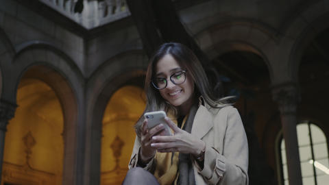 Student using smartphone in college. Businesswoman typing on cellphone outside Live Action