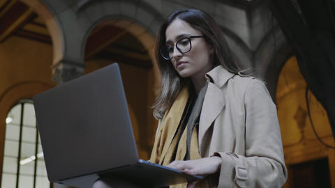 Student reading on laptop screen at college. Businesswoman working on laptop Live Action