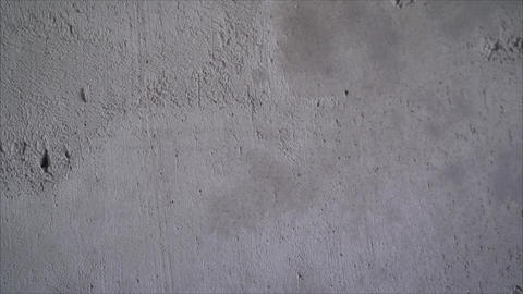 Concrete wall. Primed concrete wall. Repair work, priming and painting a bare Live Action