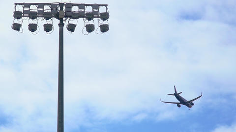 Commercial Passenger aircraft jet arriving and landing at airport. SLOW MOTION Live Action