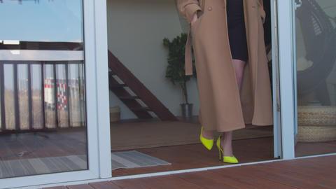 Slim female legs in high heel shoes walking on terrace Live Action