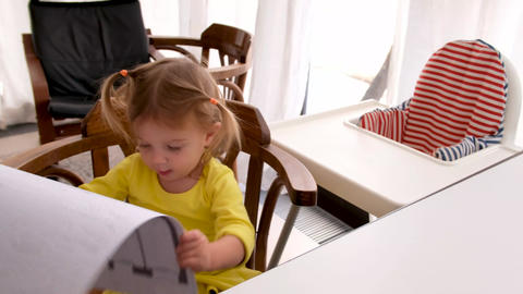 Curious small kid examining draft pretending adult in parent workplace at home Live Action