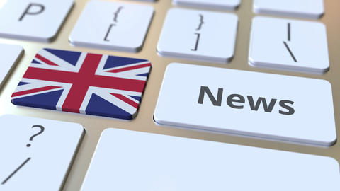 News text and flag of Great Britain on the keys of a computer keyboard. National Live Action