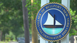 The town sign for Bellport, NY Footage