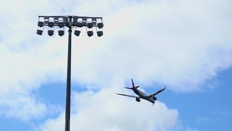Commercial Passenger aircraft jet arriving and landing at airport. SLOW MOTION 4K Live Action