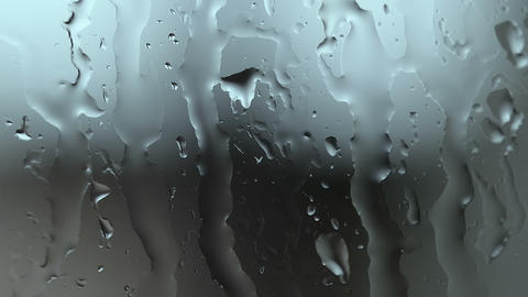 Rain water drops on glass over blurred blue background,abstract liquid motion Live Action