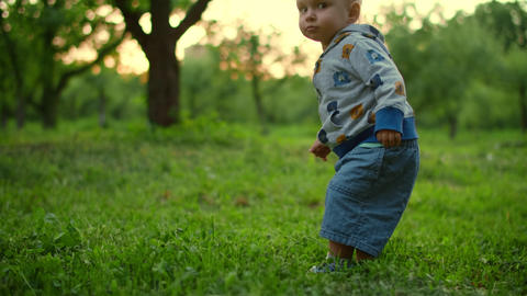 Little baby walking in green forest. Close up of adorable toddler outdoors Live Action