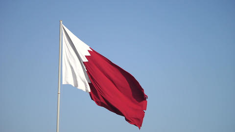 Elegant Qatar flag flying in the sky on a bright sunny day in slow motion Live Action