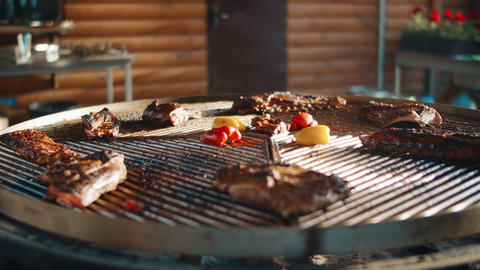 Close up of bbq for picnic outside. Grilled meat and vegetables outdoors Live Action