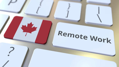 Remote Work text and flag of Canada on the computer keyboard. Telecommuting or ライブ動画
