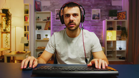 Professional gamer keeping his head on the office Live Action