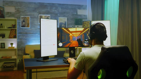 Back shot of pro gamer celebrating his victory Live Action