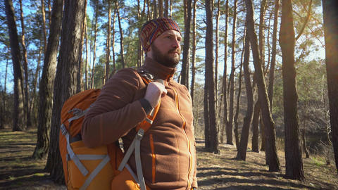 Be on time in travel and adventures. Waist up portrait of bearded man traveler Live Action