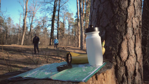 things for tourism travel for eco tourism in nature forest. Paper map, compass Live Action