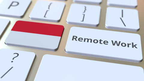 Remote Work text and flag of Indonesia on the computer keyboard. Telecommuting Live Action
