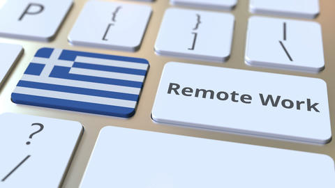 Remote Work text and flag of Greece on the computer keyboard. Telecommuting or Live Action