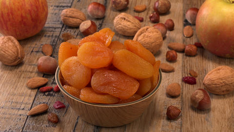 Apricots, Dried fruit composition on wood background Live Action
