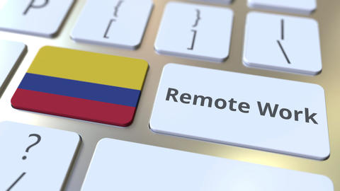 Remote Work text and flag of Colombia on the computer keyboard. Telecommuting or Live Action
