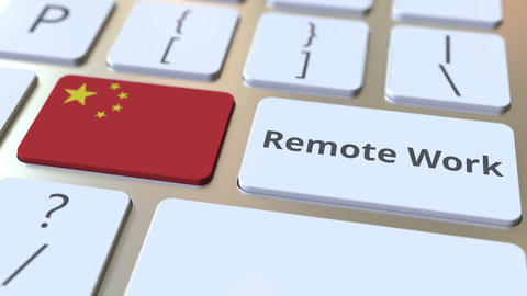 Remote Work text and flag of China on the computer keyboard. Telecommuting or Live Action
