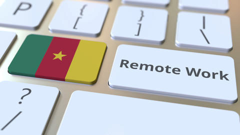 Remote Work text and flag of Cameroon on the computer keyboard. Telecommuting or ライブ動画
