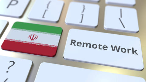 Remote Work text and flag of Iran on the computer keyboard. Telecommuting or ライブ動画