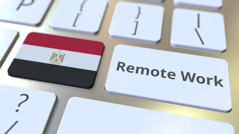 Remote Work text and flag of Egypt on the computer keyboard. Telecommuting or ライブ動画
