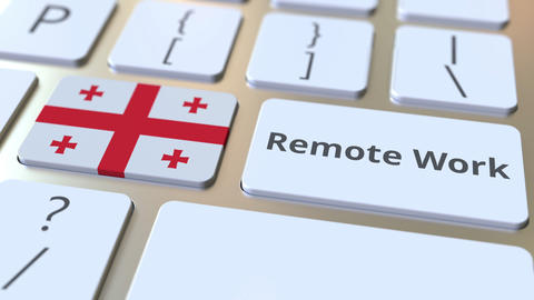 Remote Work text and flag of Georgia on the computer keyboard. Telecommuting or Live Action