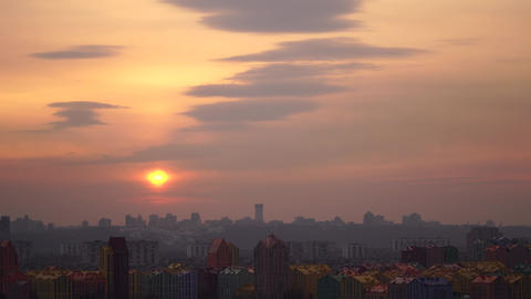 Cityscape Against dramatic Sky During Sunset with sun close up in Kiev Live Action