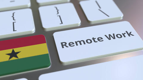 Remote Work text and flag of Ghana on the computer keyboard. Telecommuting or ライブ動画