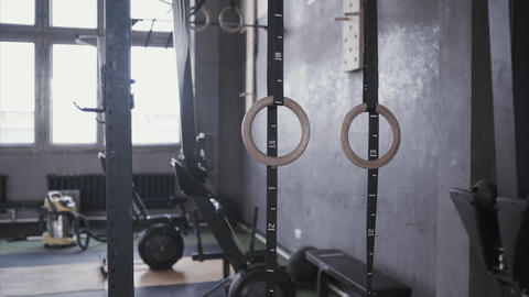 Close up, gymnastic rings hang in gym. Training equipment for pilates. Modern Live Action