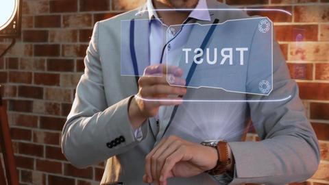 Man uses smartwatch hologram Trust Live Action