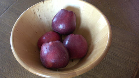 Fruits in bowl. Ripe apple in the hand of a small child Live Action