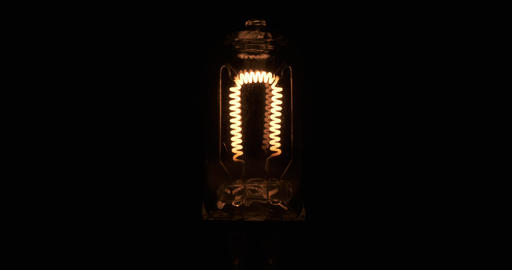 Close-up, blinking spiral of an incandescent lamp. Flicker tungsten filament Live Action